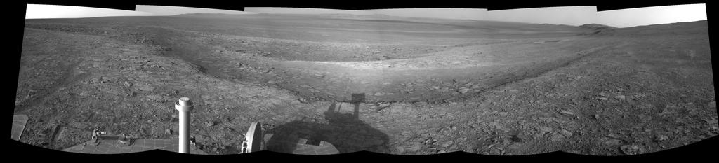 This right-eye member of a stereo pair of images from the navigation camera on NASA's Mars Exploration Rover Opportunity shows a vista across Endeavour Crater, with the rover's own shadow in the foreground.