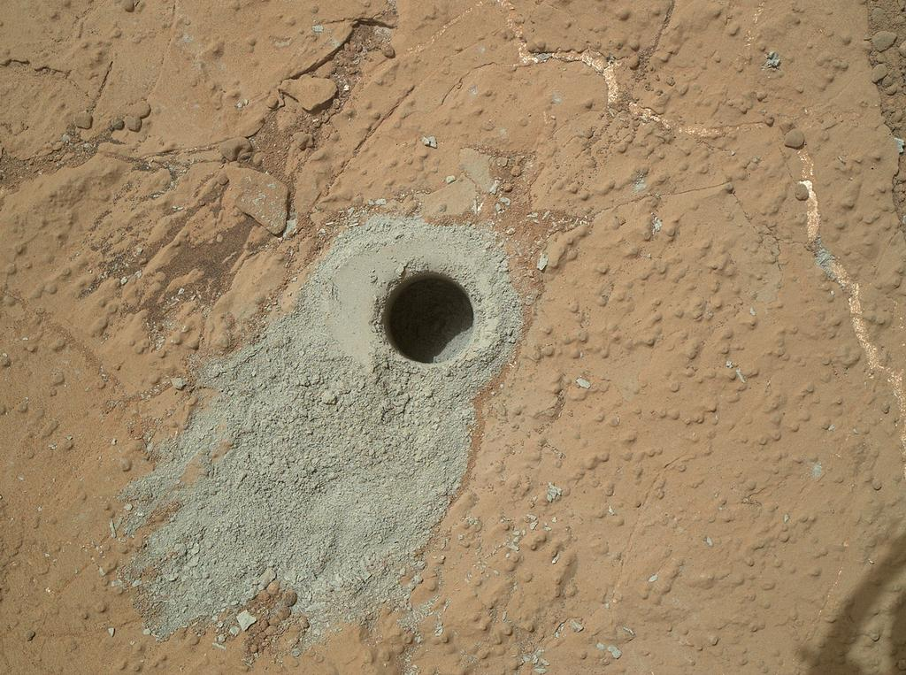 "NASA's Mars rover Curiosity drilled into this rock target, ""Cumberland,"" during the 279th Martian day, or sol, of the rover's work on Mars (May 19, 2013) and collected a powdered sample of material from the rock's interior."