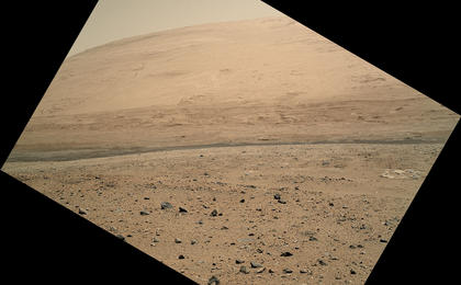 see the image 'View From Curiosity's Arm-Mounted Camera After a Long Drive'