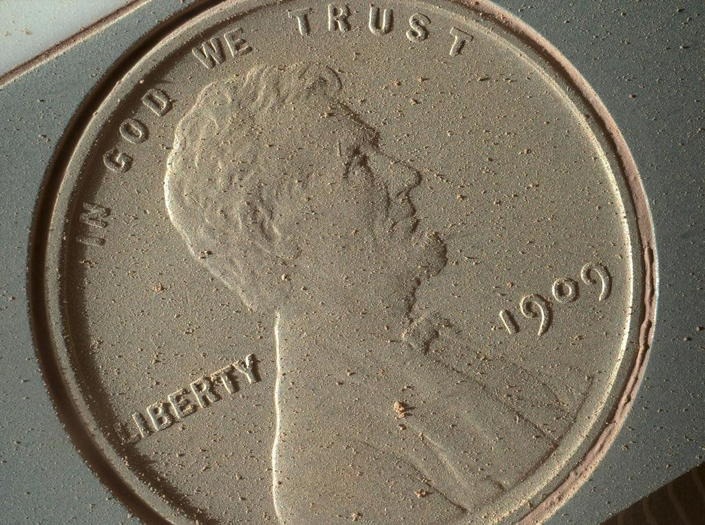 This image of a U.S. penny on a calibration target was taken by the Mars Hand Lens Imager (MAHLI) aboard NASA's Curiosity rover in Gale Crater on Mars. At 14 micrometers per pixel, this is the highest-resolution image that MAHLI can acquire.