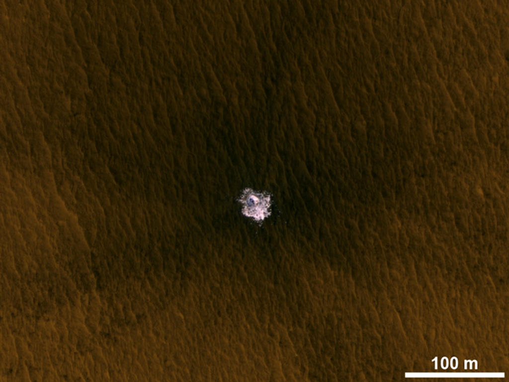 A meteorite impact that excavated this crater on Mars exposed bright ice that had been hidden just beneath the surface at this location.