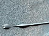 Sand dunes such as those seen in this image have been observed to creep slowly across the surface of Mars through the action of the wind.