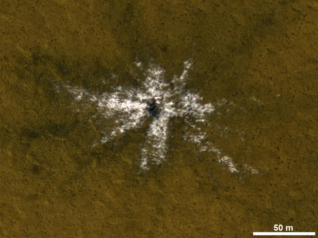 This image taken on May 19, 2010, shows an impact crater that had not existed when the same location on Mars was previously observed in March 2008.