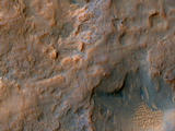 read the article 'Mars Orbiter Images Rover and Tracks in Gale Crater'