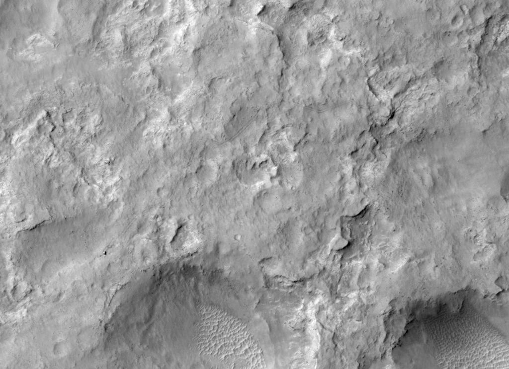 NASA's Curiosity Mars rover and tracks left by its driving appear in this portion of a Dec. 11, 2013, observation by the High Resolution Imaging Science Experiment (HiRISE) camera on NASA's Mars Reconnaissance Orbiter.