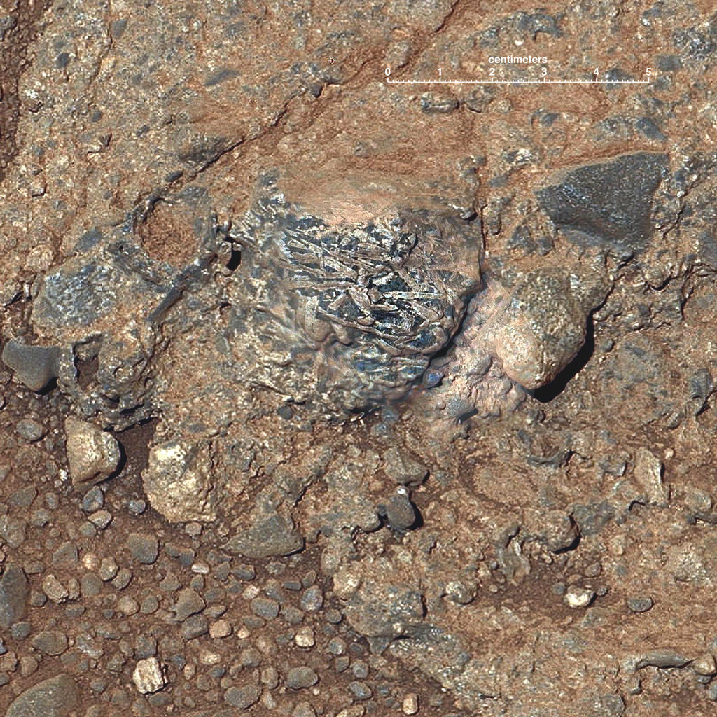 "This view of a Martian rock target called ""Harrison"" merges images from two cameras on NASA's Curiosity Mars rover to provide both color and microscopic detail."