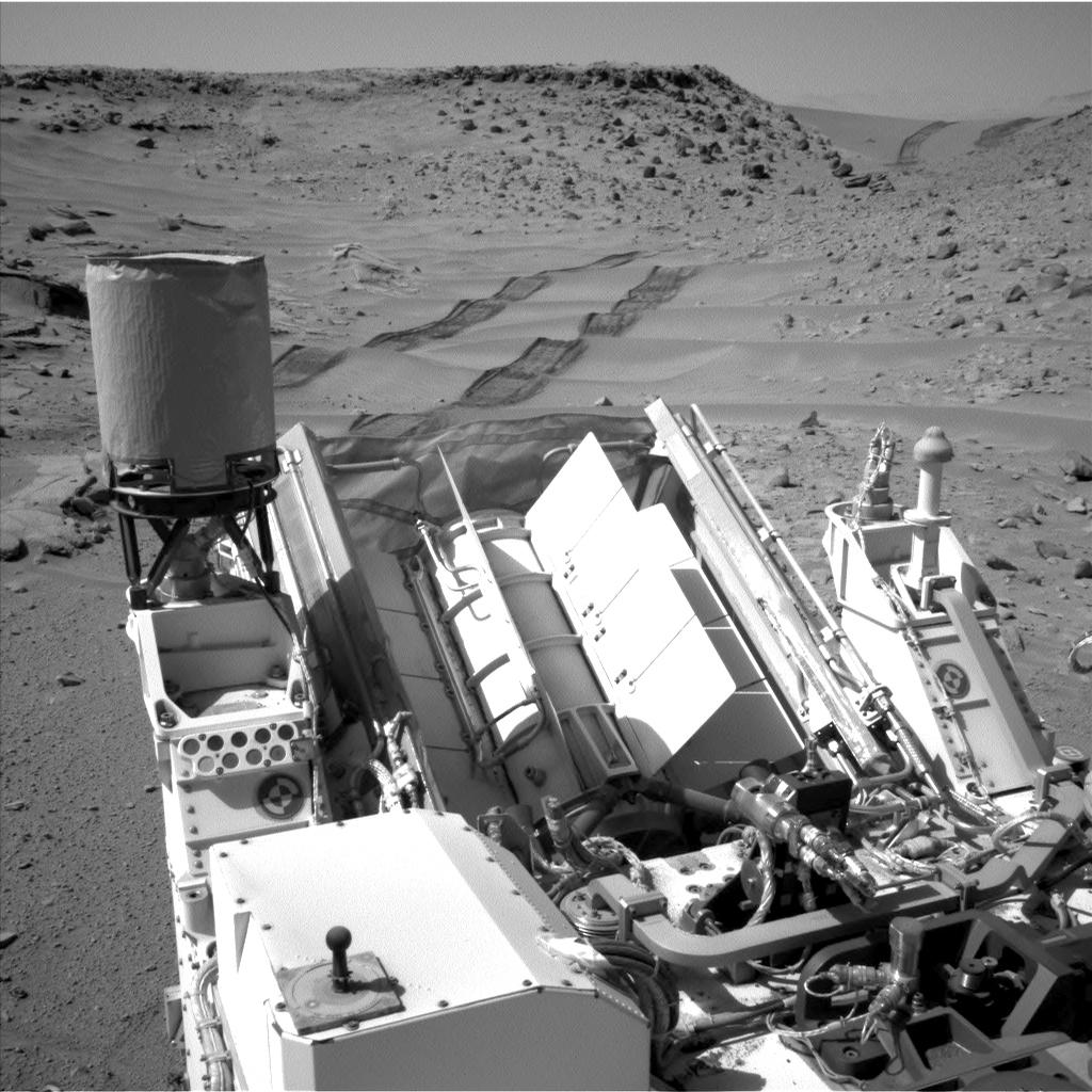 "ASA's Curiosity Mars rover used the Navigation Camera (Navcam) on its mast to catch this look-back eastward at wheel tracks from driving through and past ""Dingo Gap"" inside Gale Crater."