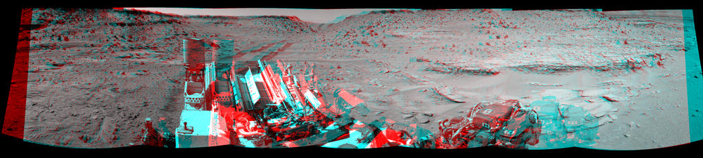 "This stereo view combining images taken on Feb. 10, 2014, by the Navigation Camera (Navcam) on NASA's Curiosity Mars rover looks back to where the rover crossed a dune at ""Dingo Gap"" four days earlier. It appears three dimensional when viewed through red-blue glasses with the red lens on the left."