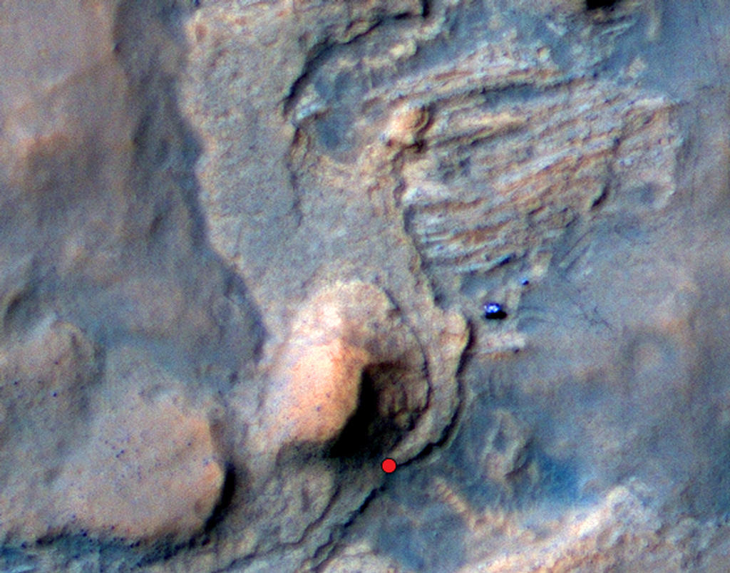 "In this Mars Reconnaissance Orbiter view of the Curiosity rover mission's waypoint called ""the Kimberley,"" the red dot indicates the location of a sandstone target, ""Windjana,"" selected for close-up inspection. The"