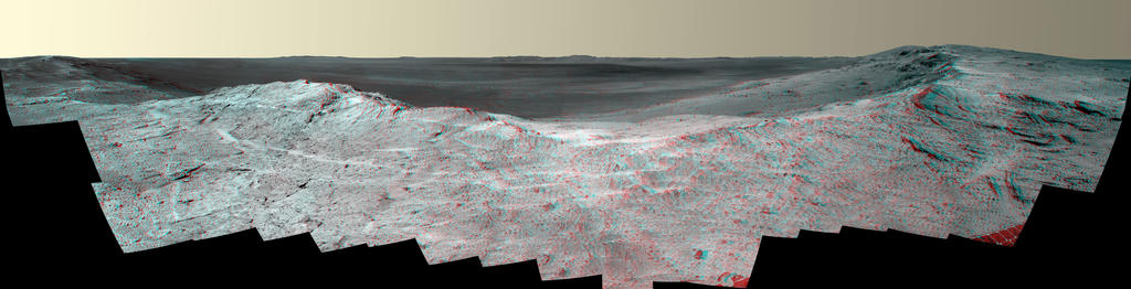 "This stereo vista from the panoramic camera (Pancam) on NASA's Mars Exploration Rover Opportunity catches ""Pillinger Point,"" on the western rim of Endeavour Crater, in the foreground. The May 14, 2014, image appears three-dimensional when seen through blue-red glasses with the red lens on the left."