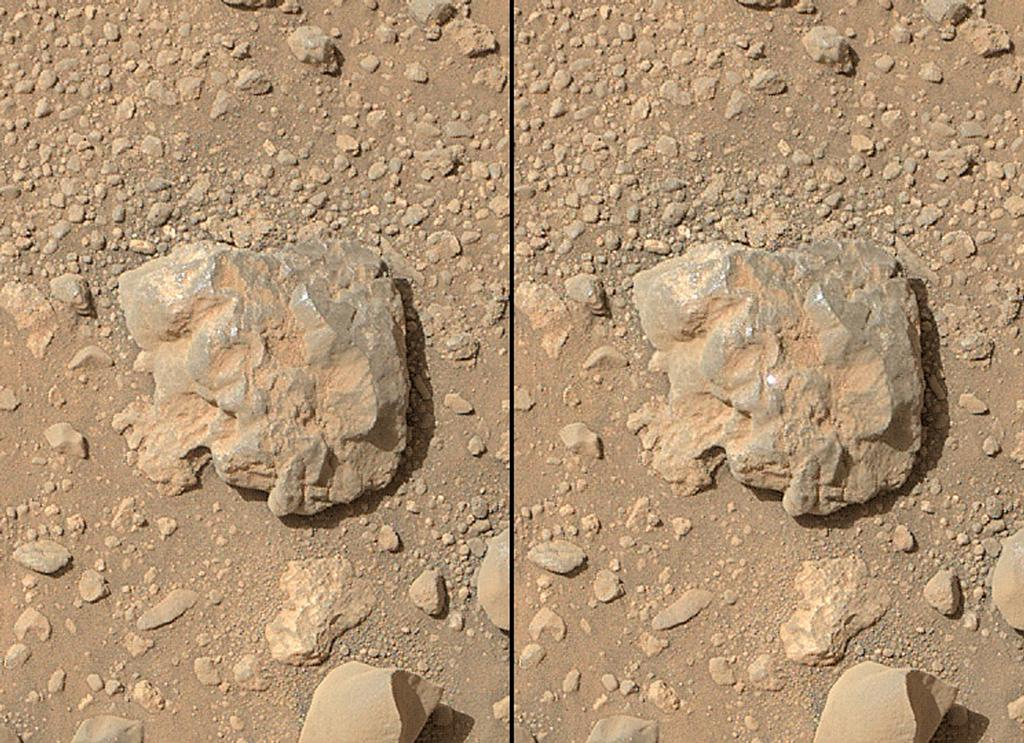 "NASA's Curiosity Mars rover used the camera on its arm on July 12, 2014, to catch the first images of sparks produced by the rover's laser being shot at a rock on Mars. The left image is from before the laser zapped this rock, called ""Nova."" The spark is at the center of the right image."