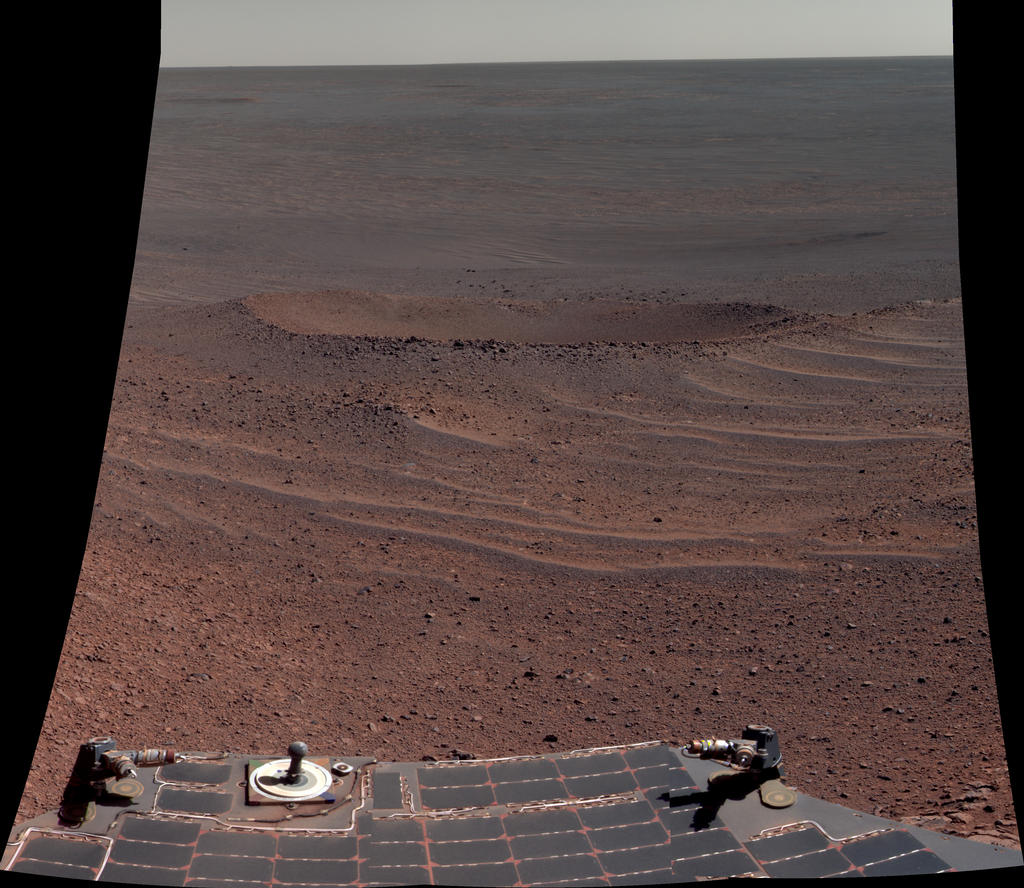 "This false-color view from NASA's Mars Exploration Rover Opportunity shows ""Lunokhod 2 Crater,"" which lies south of Solander Point on the west rim of Endeavour Crater."