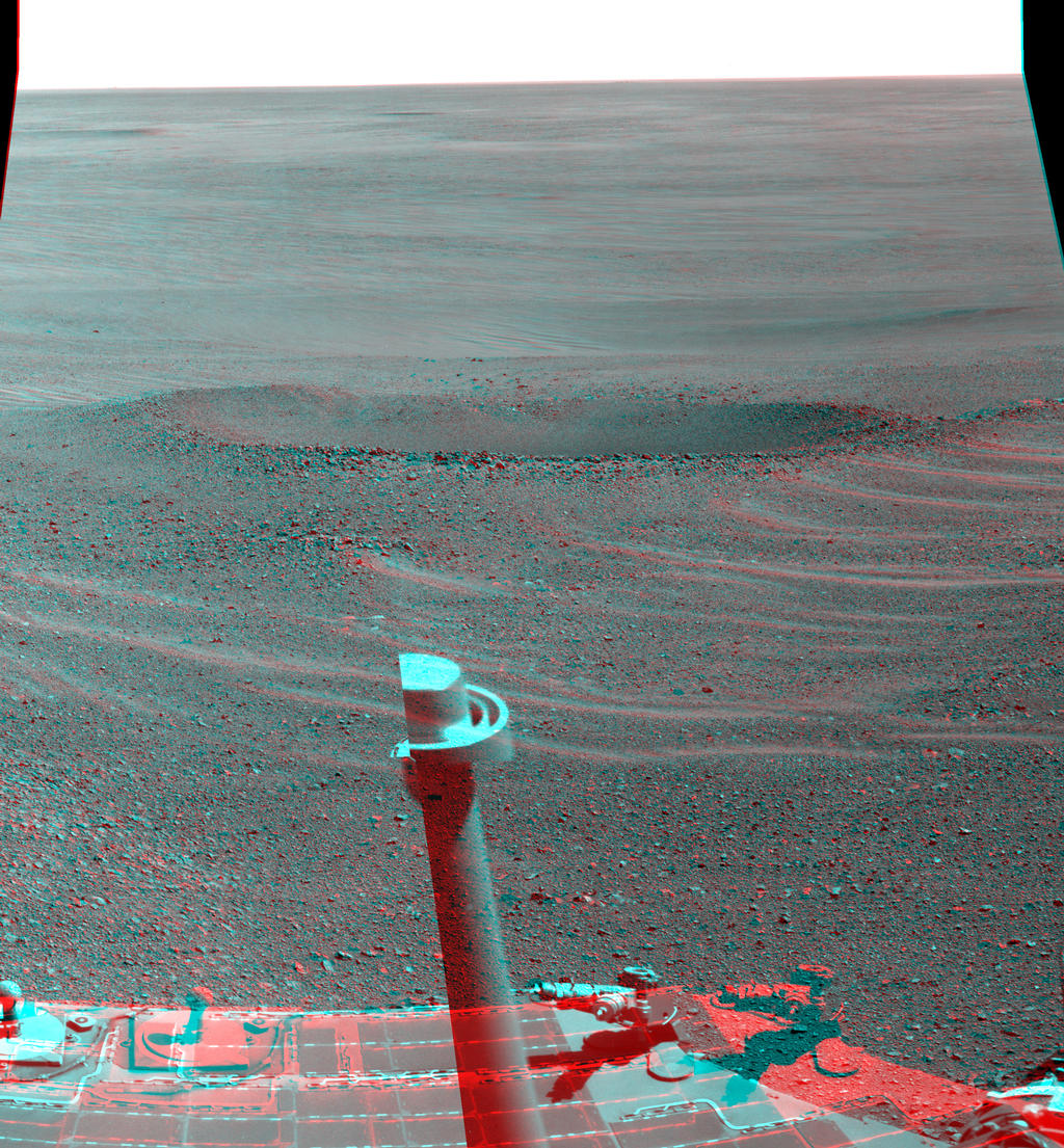 "This stereo view from NASA's Mars Exploration Rover Opportunity shows ""Lunokhod 2 Crater,"" which lies south of ""Solander Point"" on the west rim of Endeavour Crater."