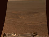 read the article 'NASA Long-Lived Mars Opportunity Rover Sets Off-World Driving Record'