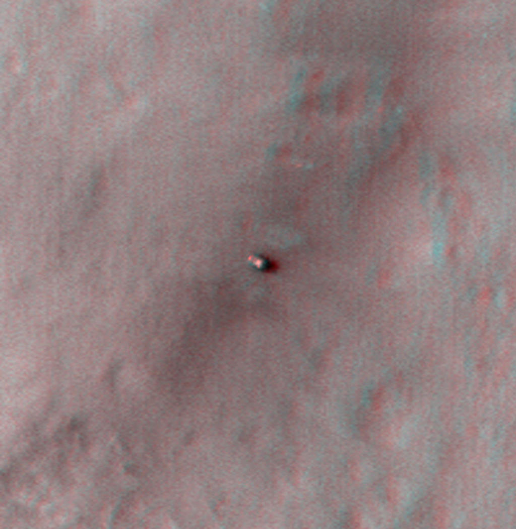 This 3D, or stereo anaglyph, view shows NASA's Mars rover Curiosity where it landed on Mars within Gale Crater, at a site now called Bradbury Landing.