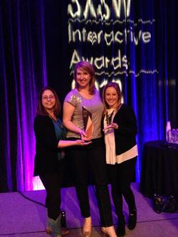 Veronica McGregor, Stephanie L. Smith and Courtney O'Connor of JPL accepted the SXSW Interactive Social Media Award.