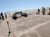 sand dune, mars rover, wheel, Dumont, Scarecrow, test - Several engineers flank the Scarecrow mobility rover on both sides as the rover drives over a sand dunes obstacle course.