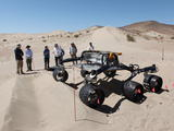 sand dune, mars rover, wheel, Dumont, Scarecrow, test - Several engineers watch as the Scarecrow test rover goes over a dunes obstacle course.