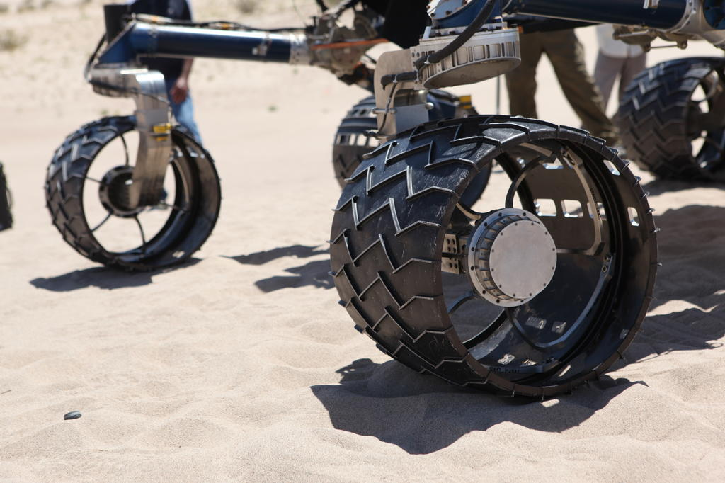 wheel, test, Scarecrow, Mars rover Rover wheels on Scarecrow with chevron-shaped treads rest on sand in Dumont dunes.