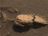 This color image taken by the panoramic camera onboard the Mars Exploration Rover Opportunity shows the part of the rock outcrop dubbed Stone Mountain at Meridiani Planum, Mars.