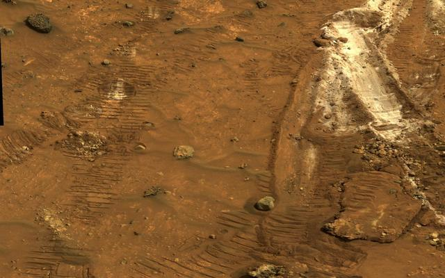 Rover's Wheel Churns Up Bright Martian Soil