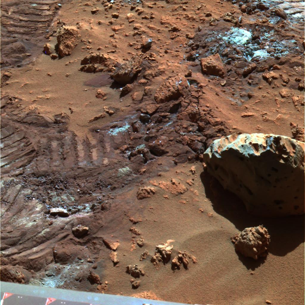 This false-color image highlights mysterious and sparkly dust-like material that is created when the soil in this region is disturbed.