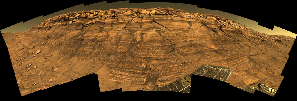 "Opportunity captured this view of ""Burns Cliff"" after driving right to the base of this southeastern portion of the inner wall of ""Endurance Crater."""