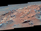 "Gazing across the landscape of the ""Columbia Hills"" in Gusev Crater on Mars, scientists saw hints of tilted rock layers across the area traversed by the Spirit rover."