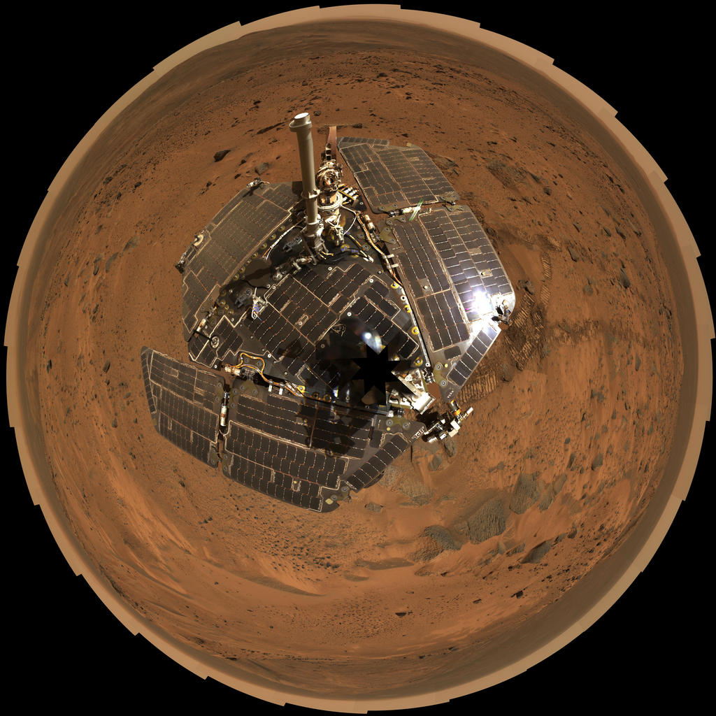 This bird's-eye view combines a self-portrait of the spacecraft deck and a panoramic mosaic of the Martian surface as viewed by the Spirit rover.