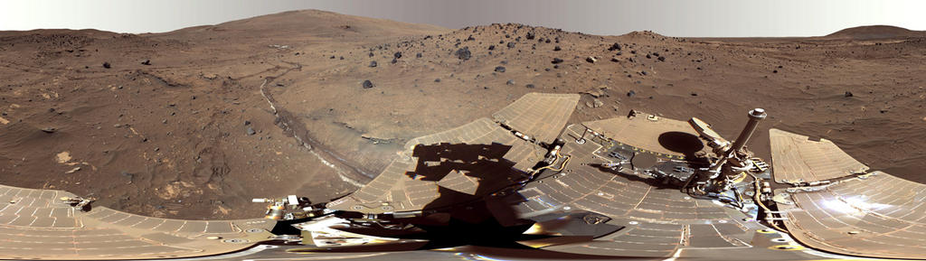 "This beautiful scene reveals a tremendous amount of detail in Spirit's surroundings at a place called ""Winter Haven,"" where the rover spent many months parked on a north-facing slope in order to keep its solar panels pointed toward the sun for the winter. During this time, it captured several images to create this high resolution panorama."