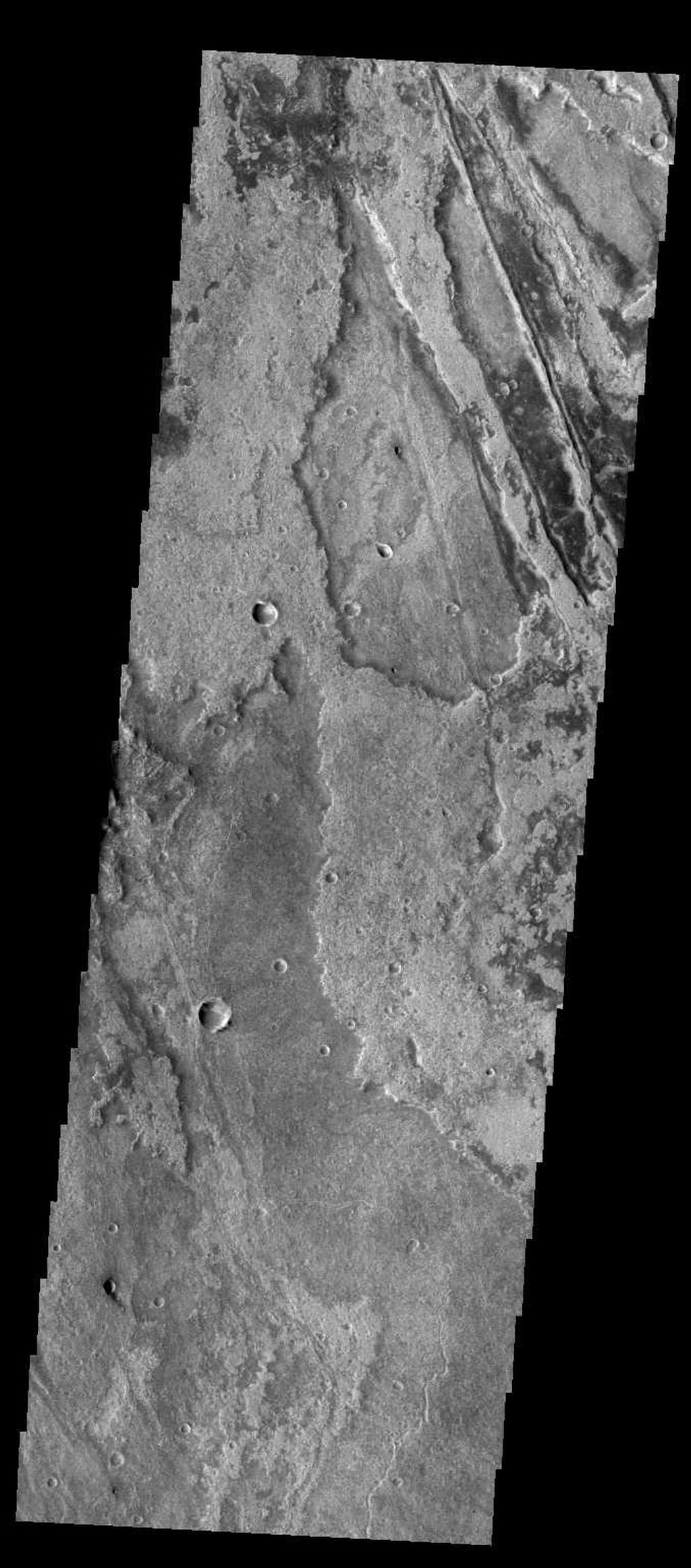 Just as on Earth, volcanism and tectonism are found together on Mars. Here is an example: the ridges and fractures of Claritas Fossae are affecting or perhaps hosting the volcanic flows of Solis Planum.