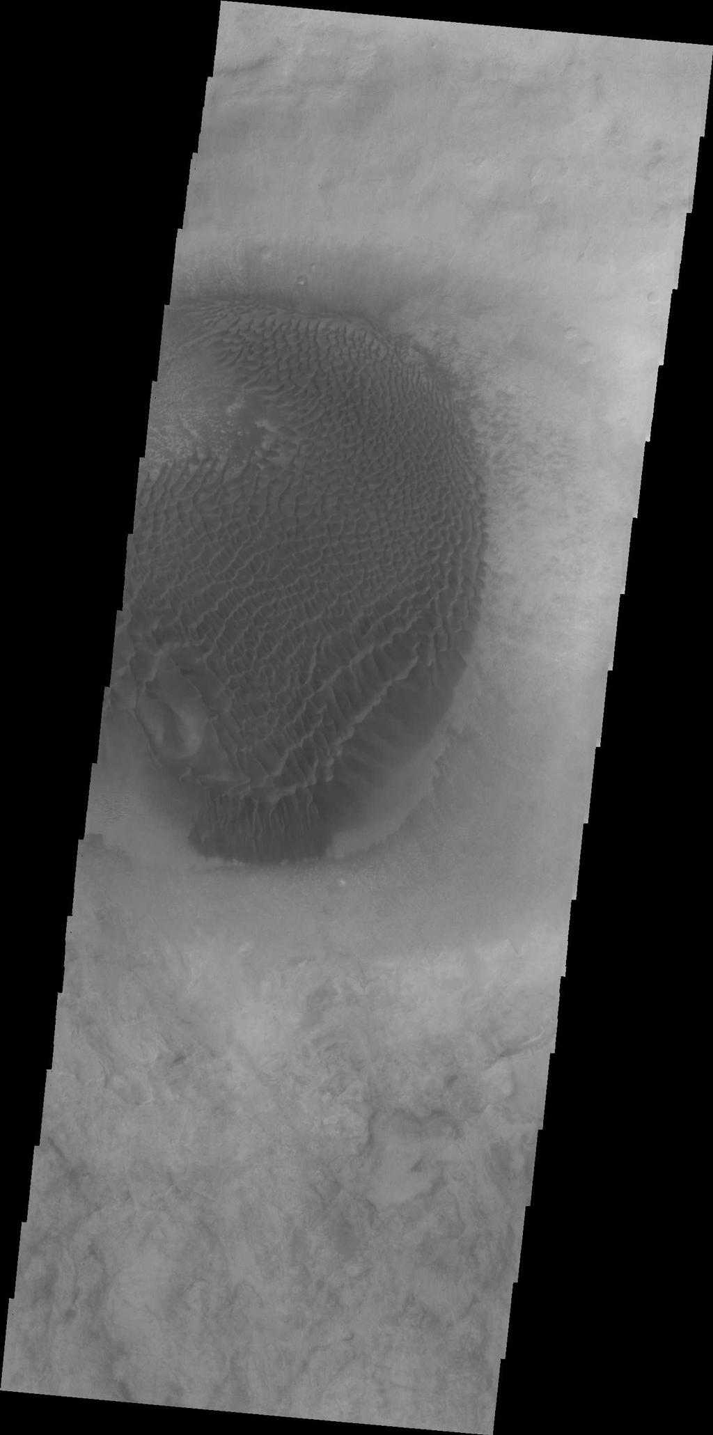 A large mound of sand and dune forms are located on the floor of an unnamed crater south of Rabe Crater in Noachis Terra.