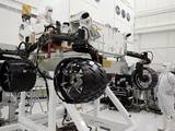 Engineers working in a clean room at NASA's Jet Propulsion Laboratory, installed six new wheels on the Curiosity rover, and rotated all six wheels at once on July 9, 2010.