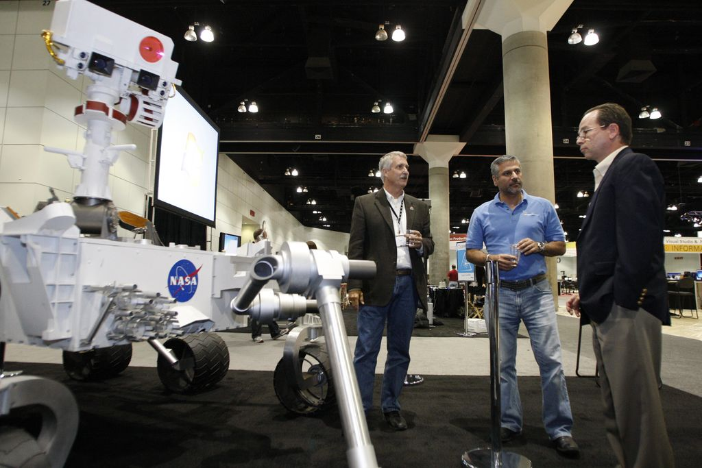 Doug McCuistion, Walid Abu-Hadba, and Roger Gibbs in the 'Big Room' at Microsoft's Professional Developers Conference, with a full-scale model of the Mars rover 'Curiosity,'scheduled to launch in 2011.