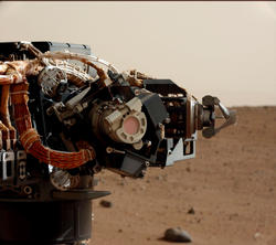Mastcam image of the Mars Hand Lens Imager (MAHLI) on Curiosity's arm, during the 30th Martian day, or sol, of the rover's mission on Mars (Sept. 5, 2012).
