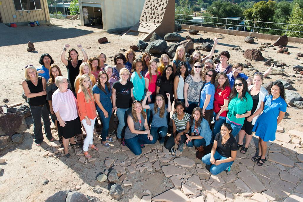 "This picture features some of the women working on the Curiosity rover, taken in the ""Mars Yard,"" a simulated martian landscape right here at JPL."