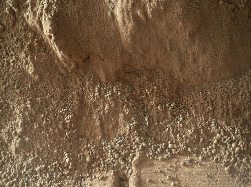 This image shows the wall of a scuffmark NASA's Curiosity made in a windblown ripple of Martian sand with its wheel.