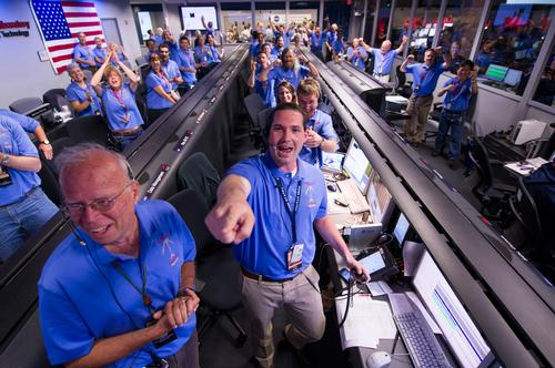 The Mars Science Laboratory (MSL) team in the MSL Mission Support Area react after learning the the Curiosity rove has landed safely on Mars and images start coming in at the Jet Propulsion Laboratory on Mars, Sunday, Aug. 5, 2012 in Pasadena, Calif. The MSL Rover named Curiosity was designed to assess whether Mars ever had an environment able to support small life forms called microbes.