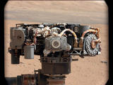 This image shows the Alpha Particle X-Ray Spectrometer (APXS) on NASA's Curiosity rover, with the Martian landscape in the background.