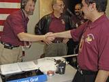 Mars Reconnaissance Orbiter Project Manager Jim Graf shakes the hand of JPL Associate Director for Programs, Project Formulation and Strategy Dr. Firouz Naderi. They are celebrating the spacecraft's successful orbit insertion.