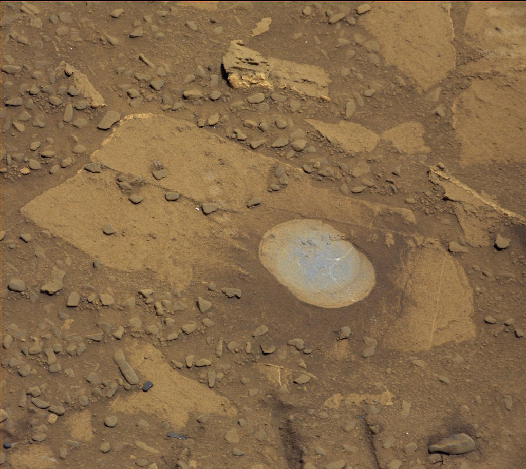 "NASA's Curiosity Mars rover used its Dust Removal Tool to brush aside reddish dust, revealing gray, less-oxidized rock material at a target called ""Bonanza King,"" visible in this Aug. 17, 2014, image from the rover's Mastcam. The rover team is evaluating this rock as a possible drilling target."
