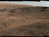 "This southeastward-looking vista from the Mast Camera (Mastcam) on NASA's Curiosity Mars rover shows the ""Pahrump Hills"" outcrop and surrounding terrain seen from a position about 70 feet (20 meters) northwest of the outcrop."