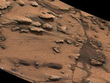 "This image shows an example of a thin-laminated, evenly stratified rock type that occurs in the ""Pahrump Hills"" outcrop at the base of Mount Sharp on Mars. The Mastcam on NASA's Curiosity Mars rover acquired this view on Oct. 28, 2014. This type of rock can form under a lake."