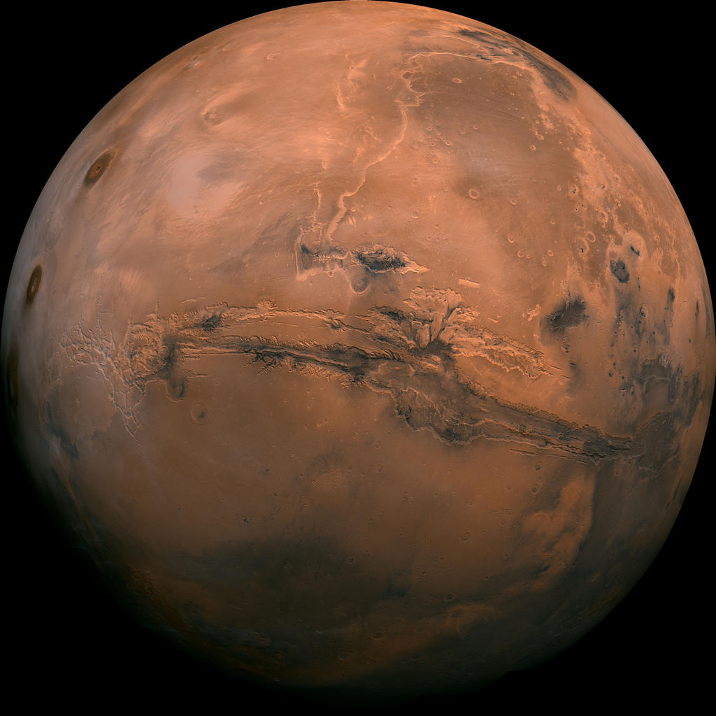 Mosaic of the Valles Marineris hemisphere of Mars projected into point perspective, a view similar to that which one would see from a spacecraft. The distance is 2500 kilometers from the surface of the planet, with the scale being .6km/pixel.