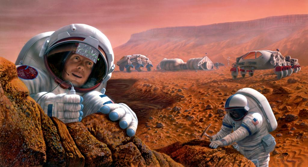 Two astronauts study a rock formation on Mars. One is seen chipping away at a rock. Two vehicles and an outpost are seen in the background.