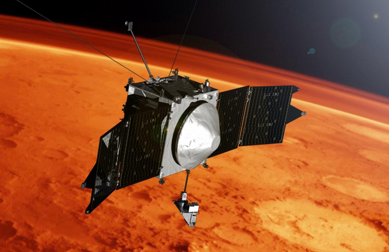 This artist concept shows the MAVEN spacecraft and the limb of Mars.