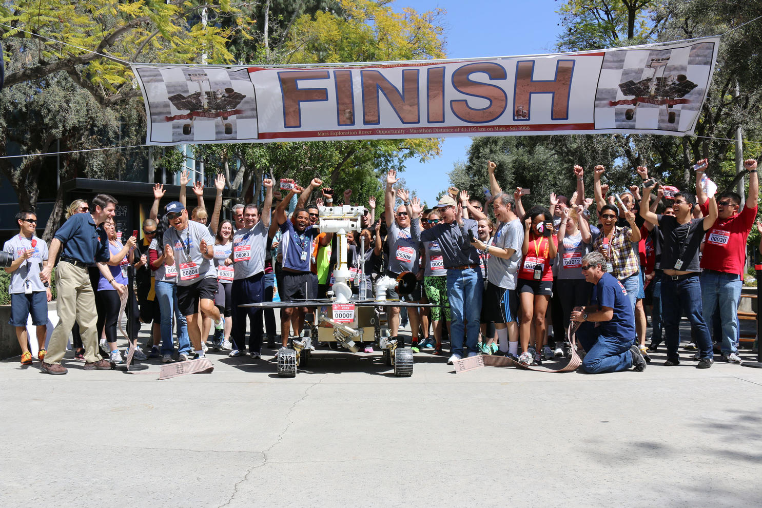 JPL employees show their support for the Opportunity rover's marathon-run on Mars, by running a marathon-length relay of their own on April 9, 2015.