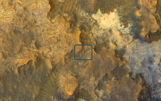 read the article 'Mars Orbiter Views Curiosity Rover in 'Artist's Drive''