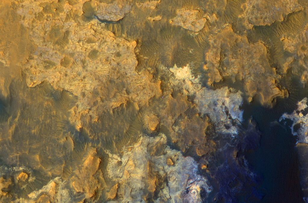 "A view from NASA's Mars Reconnaissance Orbiter on April 8, 2015, catches sight of NASA's Curiosity Mars rover passing through a valley called ""Artist's Drive"" on the lower slope of Mount Sharp."