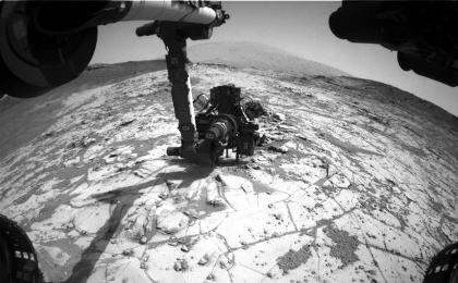 see the image 'Curiosity Conducting Mini-Drill Test at 'Mojave''